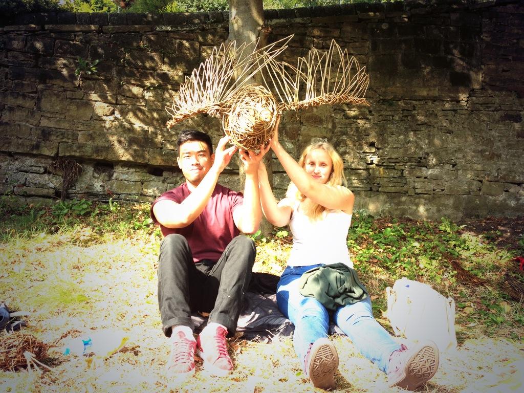 Volunteers with goose sculpture