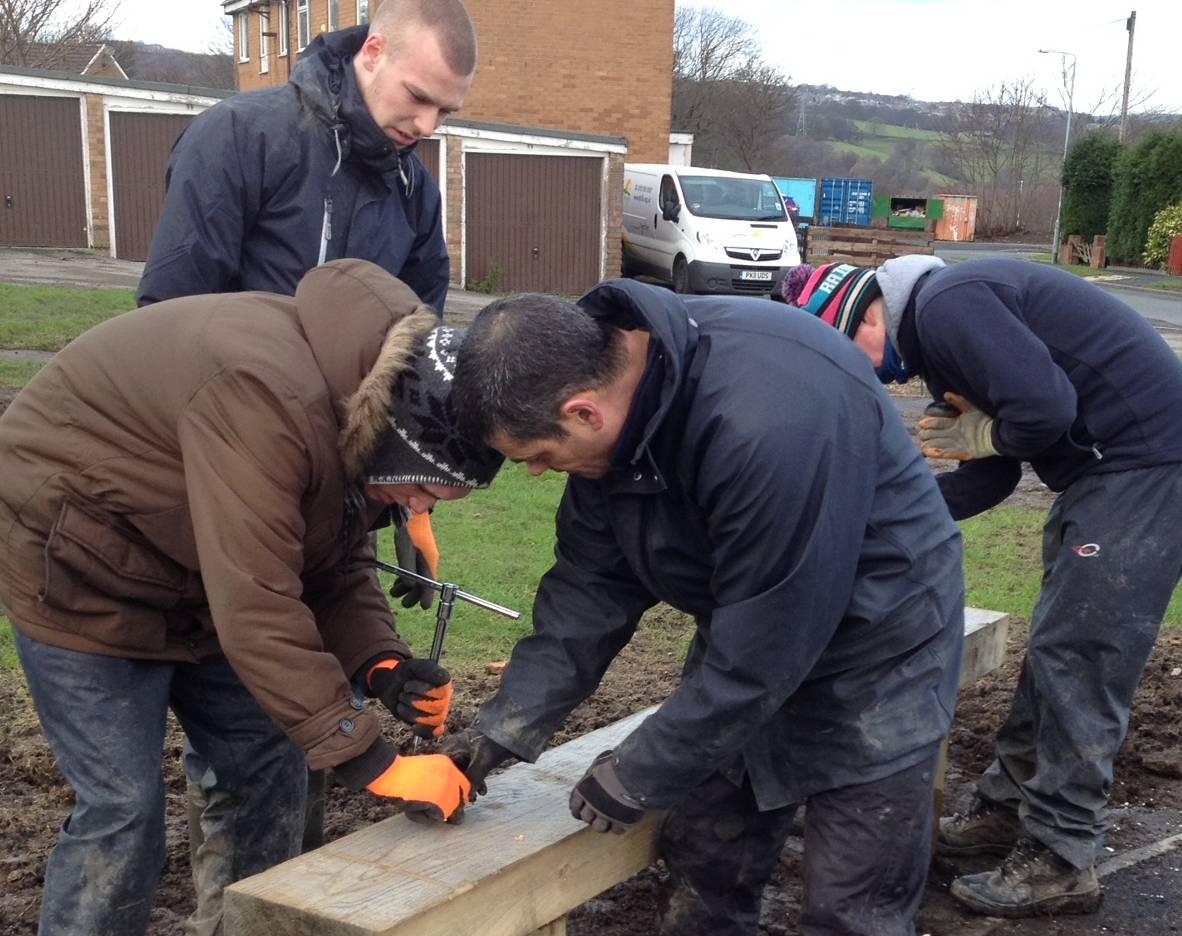 Volunteers work on site