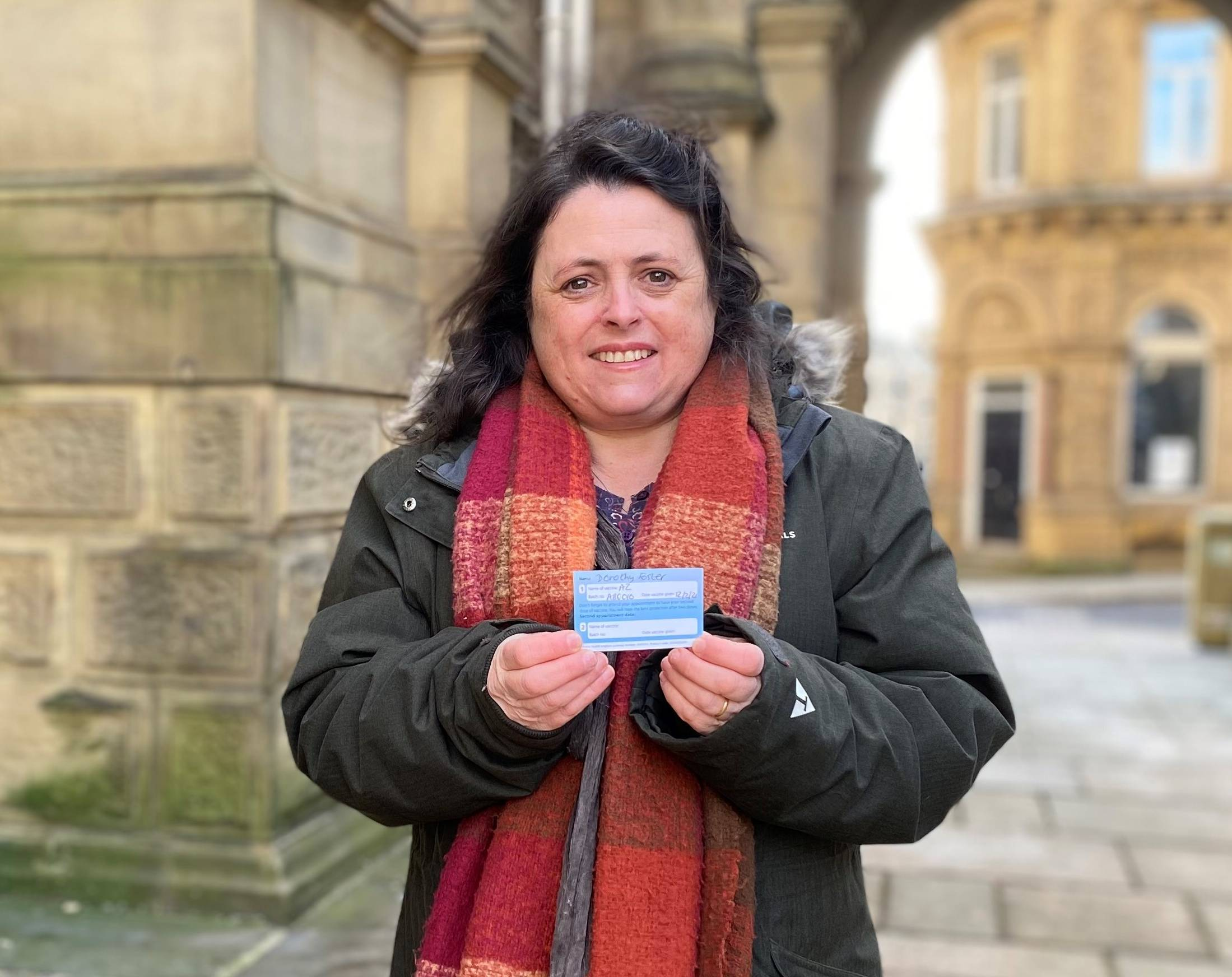 Cllr Dot Foster with her COVID vaccine card